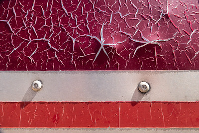 Abstract lines with peeling paint in red