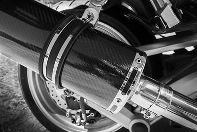 Carbon fiber muffler in black and white