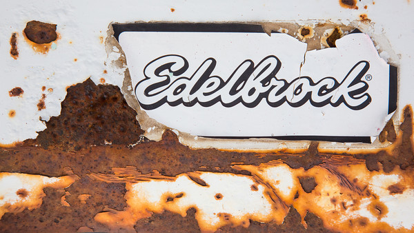 """Edelbrock""<br /> <br /> Larry, the owner of the Ranch, has some very cool old trucks on the property. One day I went out and photographed some details on the trucks. This is the rust and peeling paint on the bumper of one of them. Taken in Douglas County, Colorado, USA."