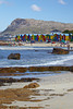 Children playing while adults look on. Taken at the colorful beach houses of Muizenberg, South Africa, Africa.