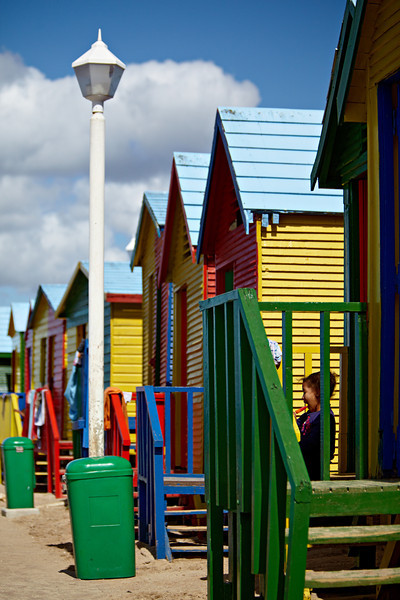"""""""Little Girl Eating Her Popsicle at the Colorful Beach Houses of Muizenberg""""<br /> <br /> A young girl happily eats her popsicle on a hot day at the beach. Taken at the colorful beach houses of Muizenberg, South Africa, Africa."""
