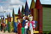 People gathered at the colorful beach houses of Muizenberg, South Africa, Africa.