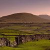 Distant Ingleborough Hill at Sunset
