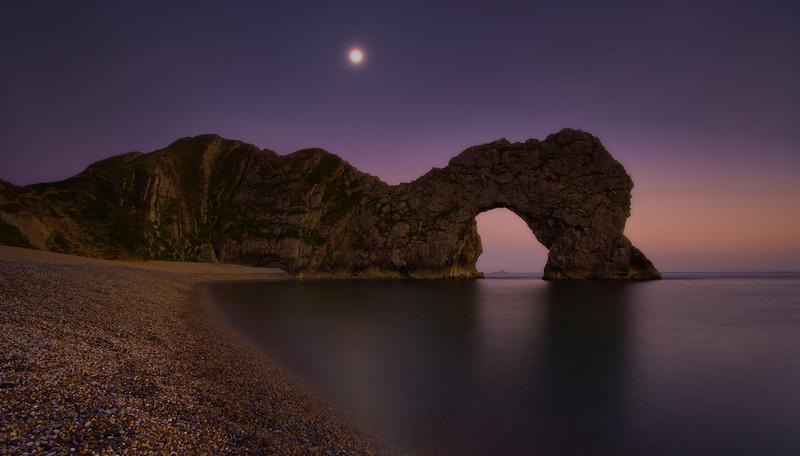 Durdle Door dusk with moon