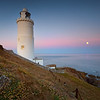 Start Point Lighthouse and full moon, Devon