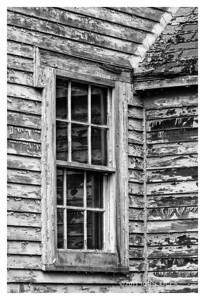Window Reflecting Peeling Paint