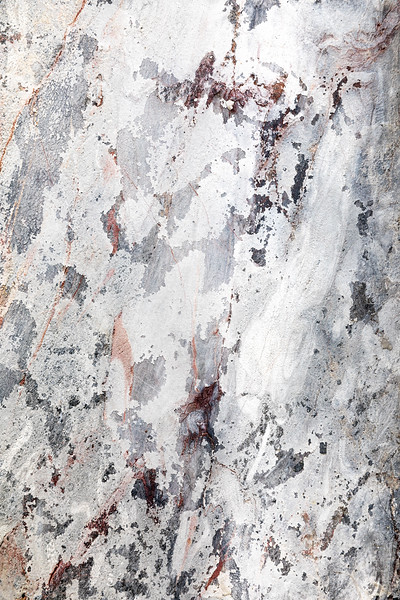 Marble effect grunge wall background.