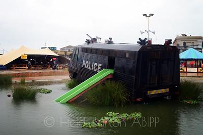 Riot van water park by Banksy