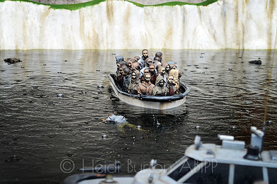 Migrant remote control boat attraction by Banksy