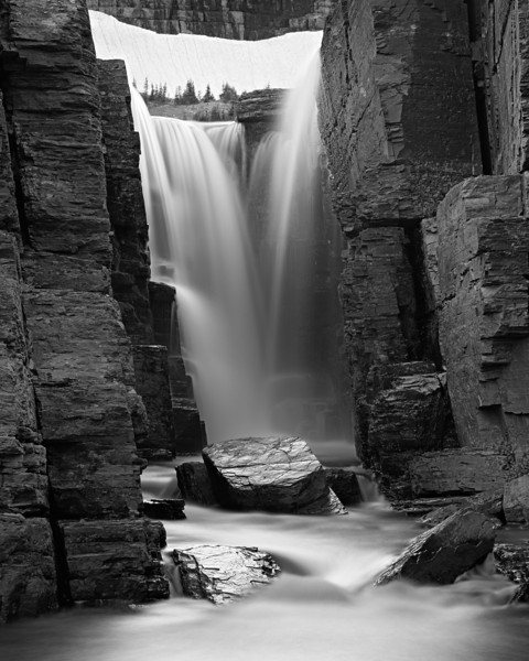 """Below Triple Falls I""<br /> <br /> Triple Falls, which spills into Reynolds Creek, in the high country of Glacier National Park, Montana, USA. That is snow up above the falls, still there in August. The previous winter had been a particularly snowy one."