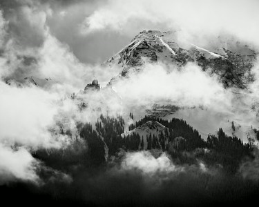 """Clearing Storm on the Dallas Divide""  This image shows clouds as they begin to clear, exposing the San Juan Mountains after a snowstorm. Taken on the Dallas Divide in the San Juan Mountains of Colorado, USA."