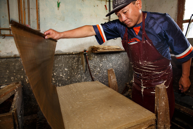 Pressing fiber in paper factory (Thimphu)