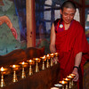 Monk lighting candles at Paro Dzong