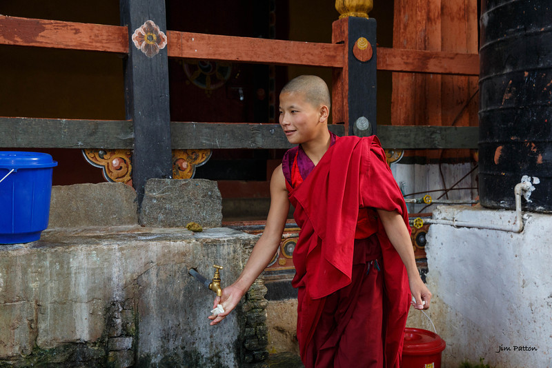 Monk washing hands at Paro Dzong