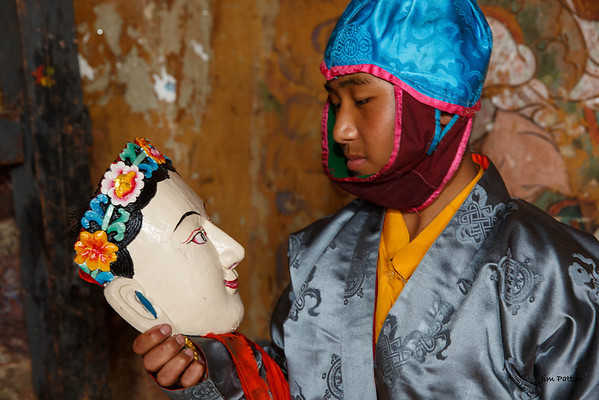 Tamshing Festival performer contemplates his mask (Bumthang)