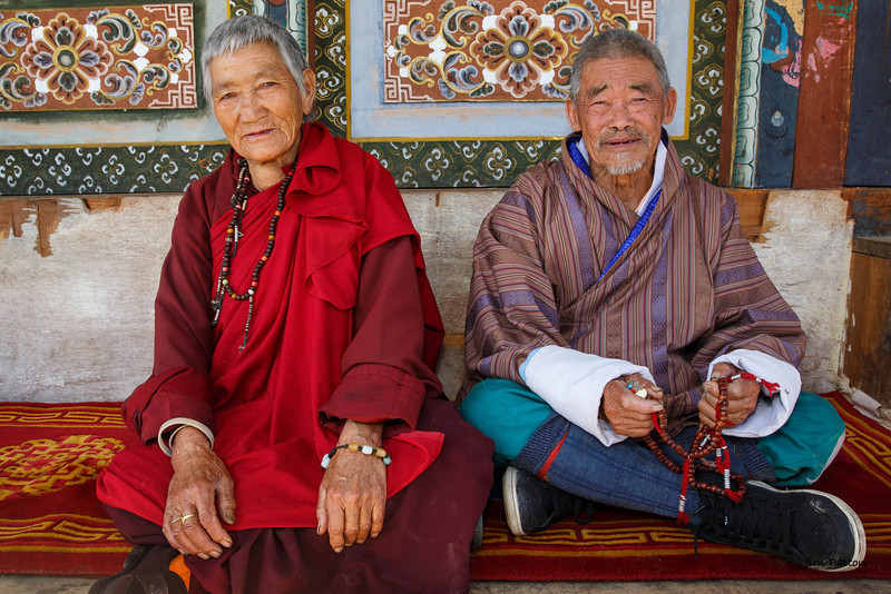 Bumthang veterans take in the festival. Both are in their last 80's
