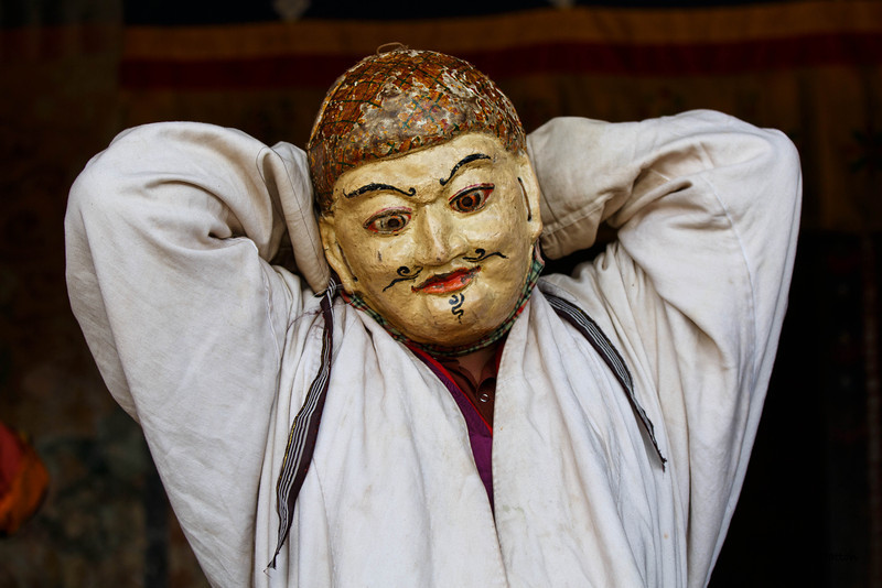 Tamshing Festival performer adjusting his mask (Bumthang)
