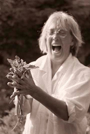 Woman in her garden laughing