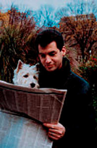 Man Reading Newspaper with Dog.