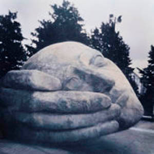 Statue of Hand Holding Head.