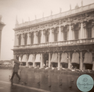 Woman walking in the rain -  Venice, Italy