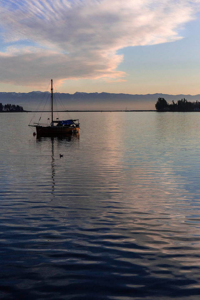 Sunset and boat, Sooke Harbour, Vancouver Island, BC, Canada