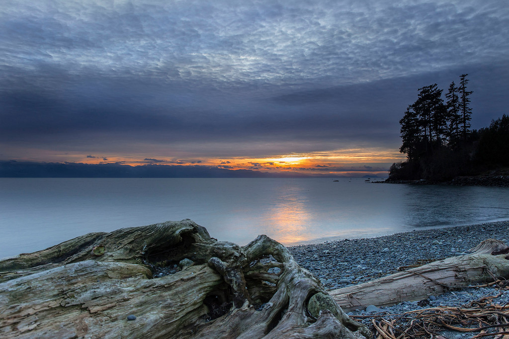 Sunset over the water and beach in Sooke, Vancouver Island, BC, Canada