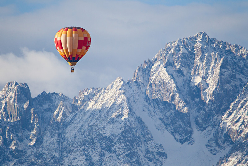 """Extreme Ballooning""<br /> <br /> A hot air balloon floats in the sky, with the San Juan Mountains in the background. The predominant peak is 14,150-foot high Mt. Sneffels. Taken in Ouray County, Colorado, USA."