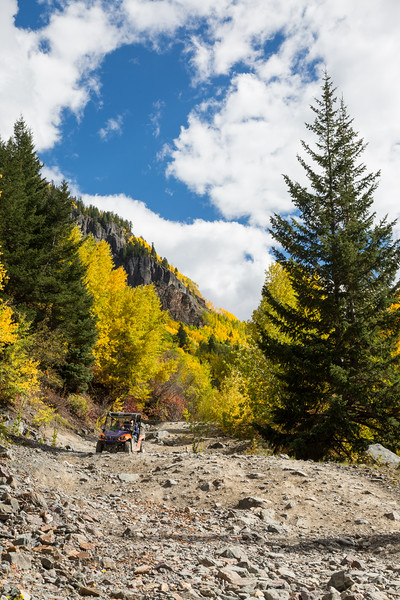 An ATV driver and passenger make their way down Engineer Pass. Taken in the San Juan National Forest, Colorado, USA.