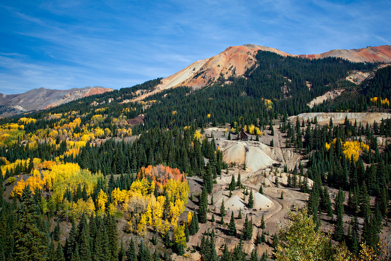 View from Red Mountain Pass, also known as The Million Dollar Highway. The Yankee Girl Mine can be seen above one of the piles of mine tailings. Taken in Ouray County, Colorado, USA.