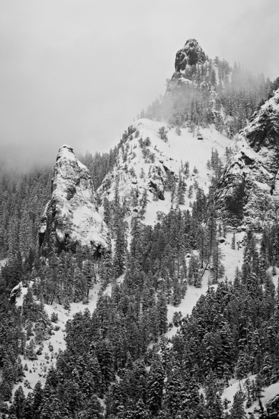 Clouds begin to clear, exposing the San Juan Mountains after a snowstorm. Taken on Red Mountain Pass near Ouray, in the San Juan Mountains of Colorado, USA.