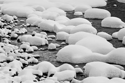 """Cooler Times""  When it's hot, it makes me want to look at images from cooler times. These are snow pillows after a winter storm, on the Dolores River. Taken in the San Juan National Forest, Colorado, USA."