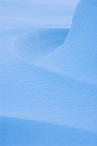 """Snow Curves""  The winter of 2006-2007 brought many snowstorms to Colorado. Down in Castlewood Canyon, the deep drifts formed into sensuous curves."
