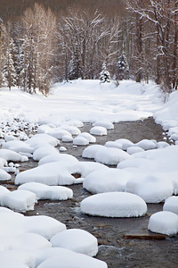 """Snowy Pillows""  Snow forms pillows on the rocks after a winter storm, on the Dolores River. Taken in the San Juan National Forest, Colorado, USA"