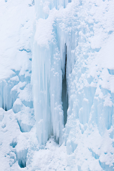 Ice takes on a blue hue in the shadow of the canyon. Taken at the Ouray Ice Park, Colorado, USA