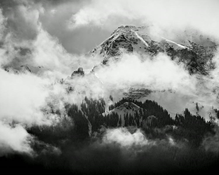 """""""Clearing Storm on the Dallas Divide""""<br /> <br /> This image shows clouds as they begin to clear, exposing the San Juan Mountains after a snowstorm. Taken on the Dallas Divide in the San Juan Mountains of Colorado, USA."""