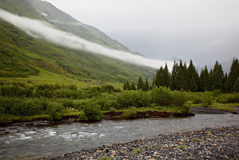 Fog and low-lying clouds along the Slate River near Crested Butte, Gunnison National Forest, Colorado, USA.