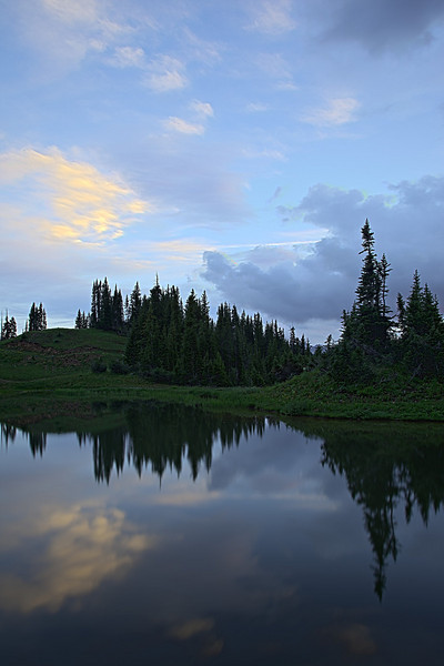 Reflections in a small pond on the Paradise Divide, near Crested Butte, Gunnison National Forest, Colorado, USA.
