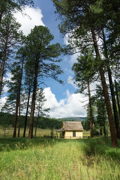 The historic Turkey Springs Guard Station, first constructed in 1921. It was rebuilt in 1935 after a fire destroyed the original structure. Then in 2014, a large ponderosa pine tree fell on the structure. It was renovated and looks like this in 2016. Taken in the San Juan National Forest, Colorado, USA.