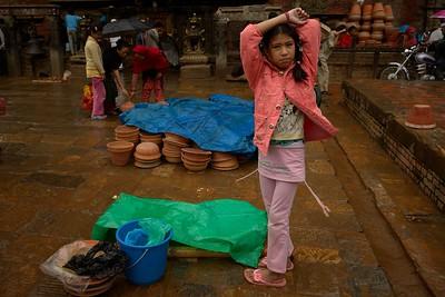 child seller under the rain