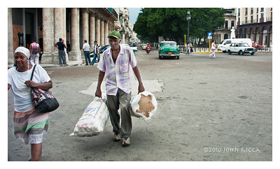 Havana Old Man Carrying Bags