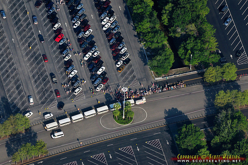 Disney World parking tram and eager visitors at the Pluto parking area