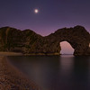 Durdle Door dusk with moon