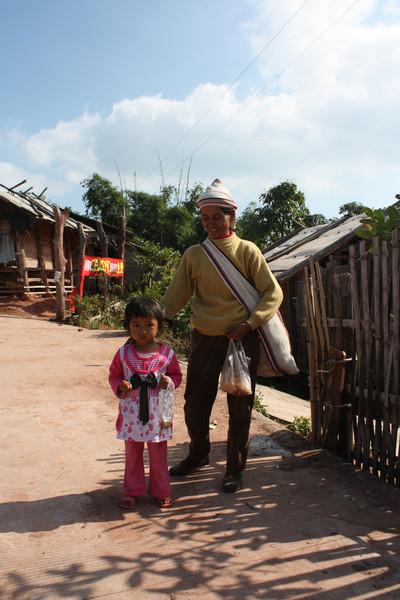 Jinuo minority lady and kid