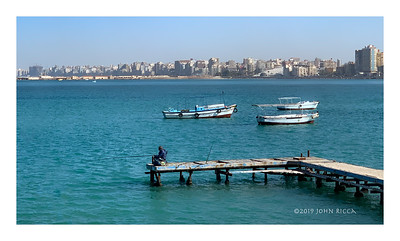 Alexandria, Boats, And A Fisherman - Egypt