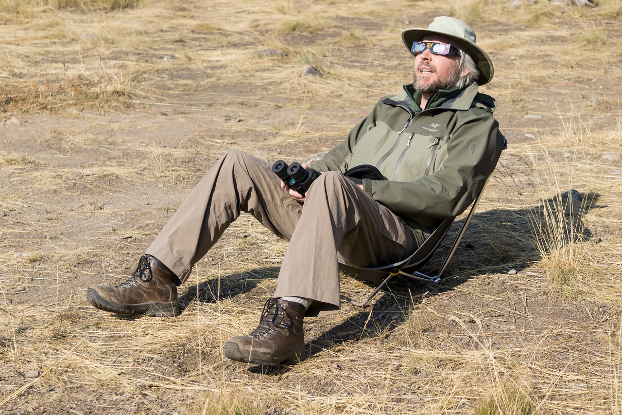 James Hager looks in awe at the August 21, 2017 total eclipse of the sun using his eclipse glasses. Taken in the Sawtooth National Recreation Area, Idaho, USA.