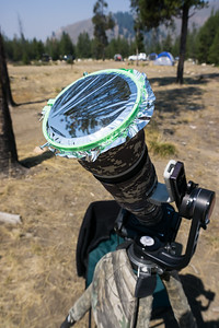 My homemade solar filter, mounted on the 500mm lens. I also had a 2X teleconverter mounted on my Canon 1DX Mark II. A Mongoose 3.6 gimbal head on the tripod made it easy to sight the eclipse at the extreme angles that were needed. I also used a remote release. Taken in the Sawtooth National Recreation Area, Idaho, USA.
