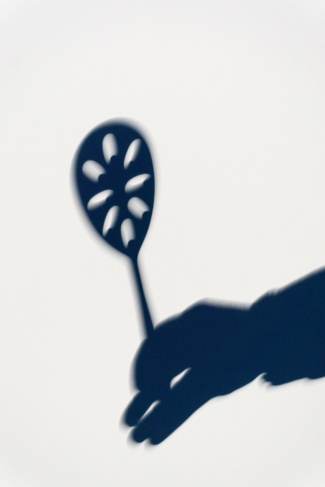 A slotted spoon projects the eclipse onto a white foam core background. Taken in the Sawtooth National Recreation Area, Idaho, USA.