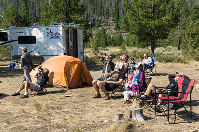 Our very nice eclipse neighbors, a large extended family group. They camped in a truck camper and several tents. Here they are enjoying the eclipse with their varied viewing methods. Taken in the Sawtooth National Recreation Area, Idaho, USA.