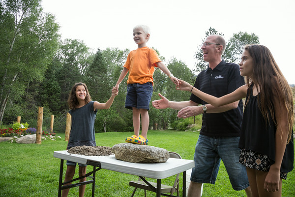 Grant Meier stands firmly on solid rock while Gabby and Elizabeth Rozendal help him and Jay Forseth stands ready. Taken at the Forseth-Rozendal Family Reunion, Nathrop, Colorado, USA.